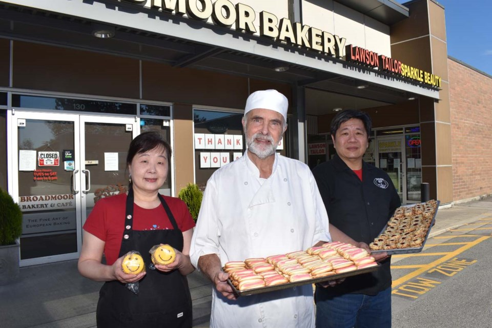 Current Broadmoor Bakery owner Tom Hsu (right), with his wife Catherine Liu (left) and former owner Gerben Beeksma. The store will close at the end of the month. Maria Rantanen photo