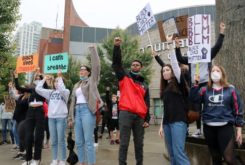 A group of anti-racism protesters march to Coquitlam city hall recently in response to concerns of police brutality in the U.S.