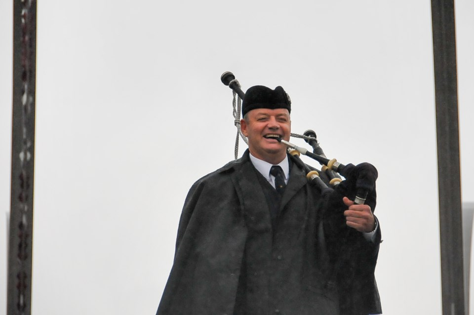 Chisholm embraces the dreary weather while playing a 'Lament to the Highland Games,' Saturday, June