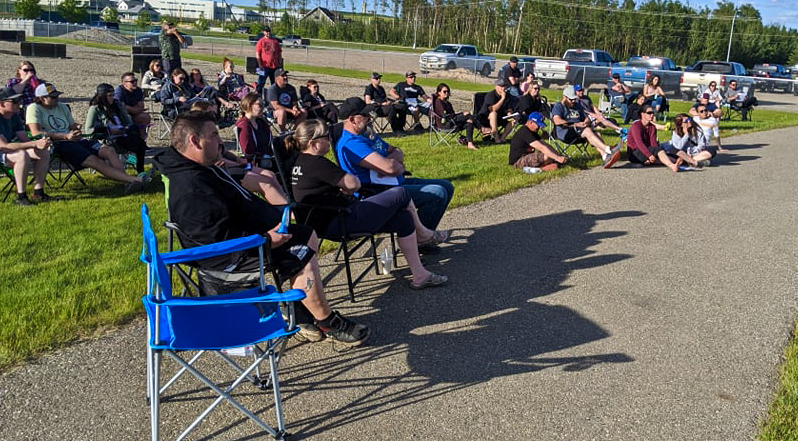 Fort St. John Mixed Slow Pitch players listen to slow pitch president Dave Sawyer speak on the new season at the Surerus Ball Diamonds on June 23, 2020.