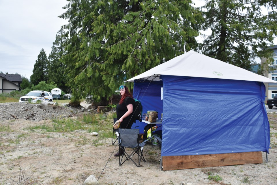 Hawkfeather Peterson stands outside a makeshift safe consumption site. It's situated on private property across the road from the Hightide Supportive Housing complex run by RainCity Housing.