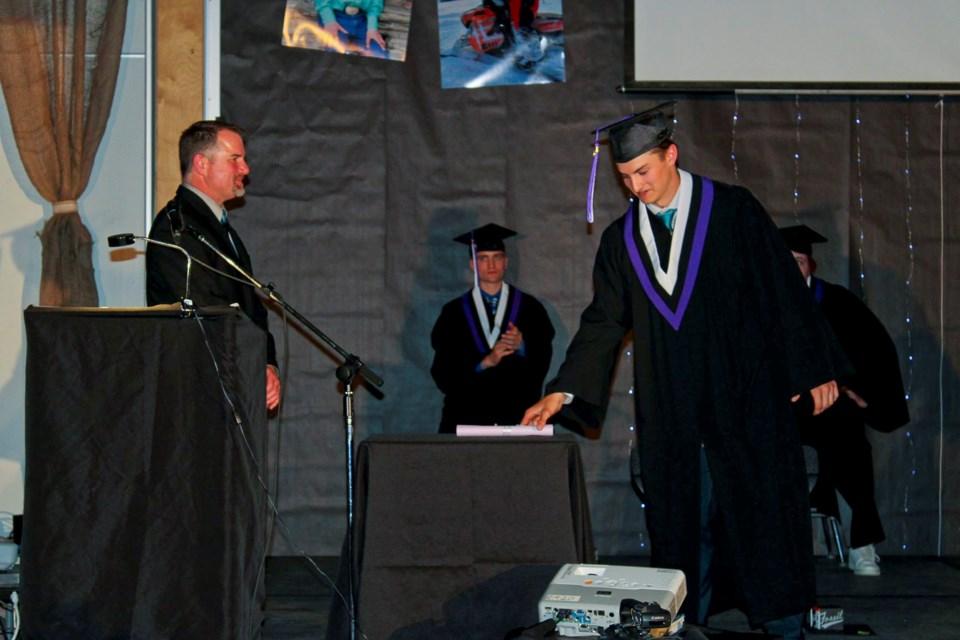 Hudson's Hope Class of 2020 grad John Herrington receives his diploma.