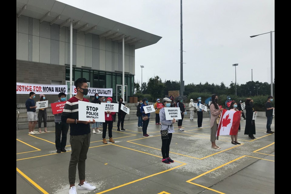 Richmond residents held another rally Saturday to show support for Mona Wang, a B.C. nursing student who was dragged and stepped on by an RCMP officer during a mental awareness check, and to protest police brutality. Photograph By Nono Shen