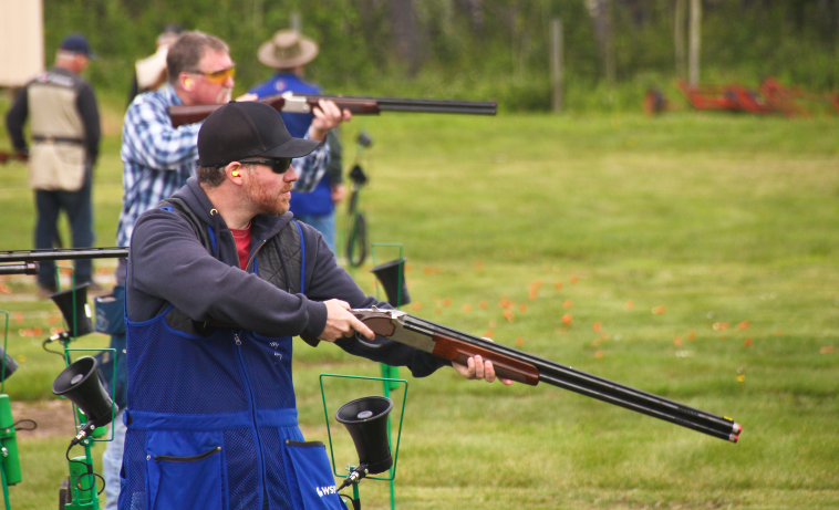 Brad Cavers admires his shot during the 2020 Oilmen's Trapshoot on July 11.