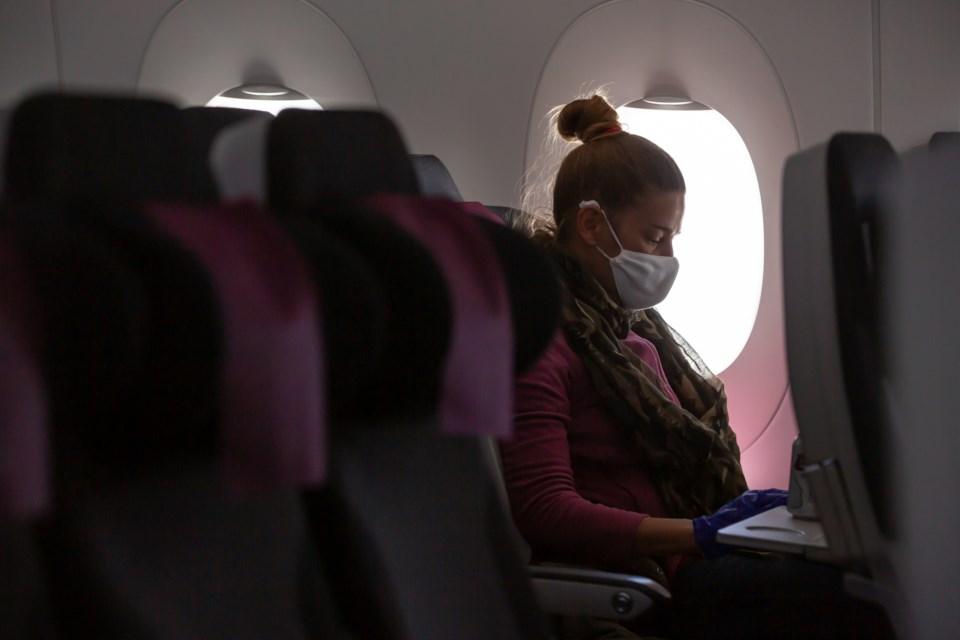 woman plane mask covid