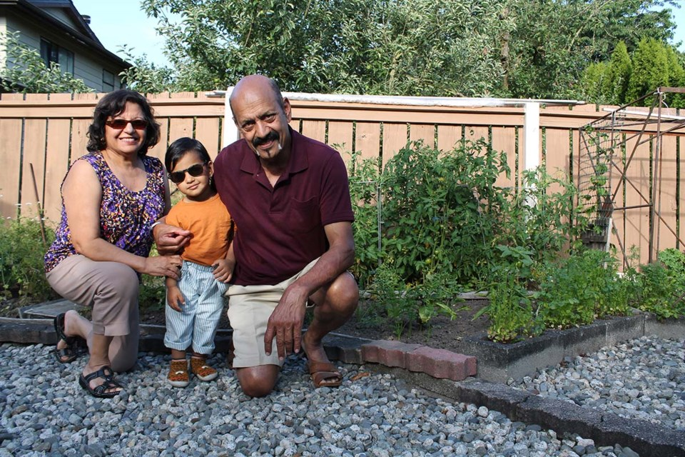 Dharma Singh (right) with this wife Minju Singh and grandson in his herb garden.