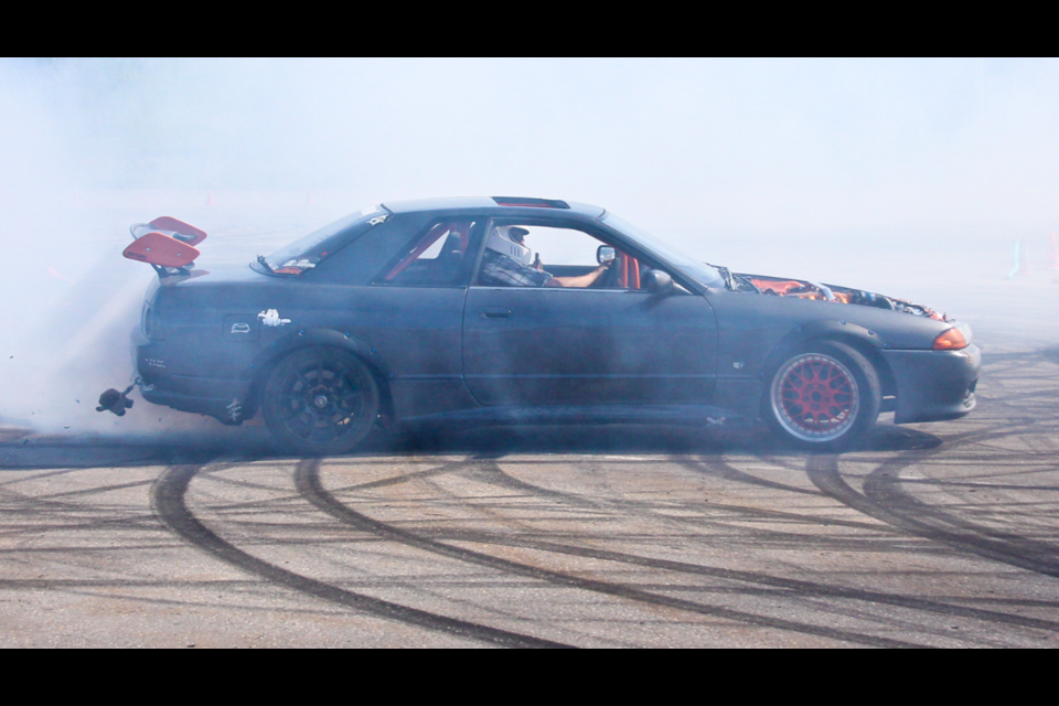 Jeremy LaFountain ends his final run of the Peace Auto Fest drift competition with a burnout big enough to see from the top of the Taylor hill on July 26, 2020. LaFountain finished the competition in third place.