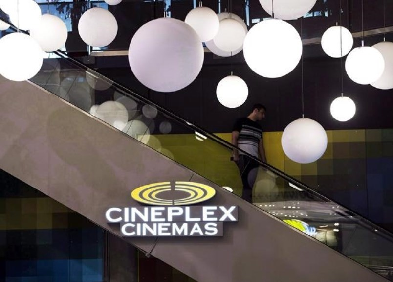 A man makes his way down an escalator during the Cineplex Entertainment company's annual general mee