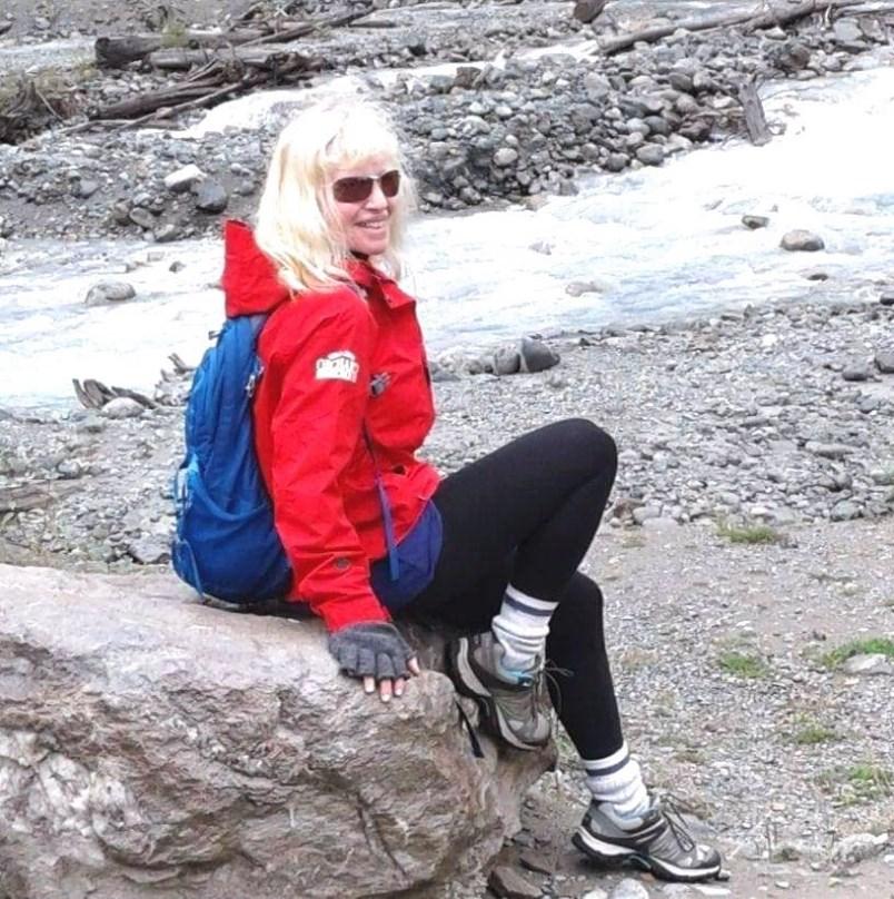 Lisa on a rock on a hike on a mountain