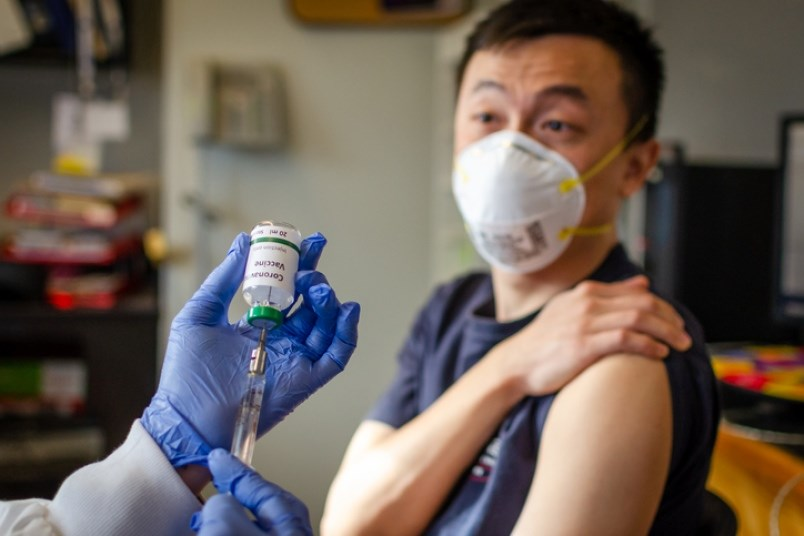 Illustrative photo of man getting vaccinated against coronavirus. No one knows when or if a coronavi