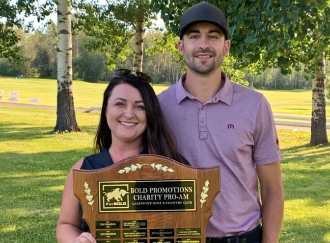 Sam Warren of Bold Promotions and Vancouver Golf Tour pro Michael Belle celebrate their respective championships in the 2020 Charity Pro-Am at Lake Point on July 30, 2020.