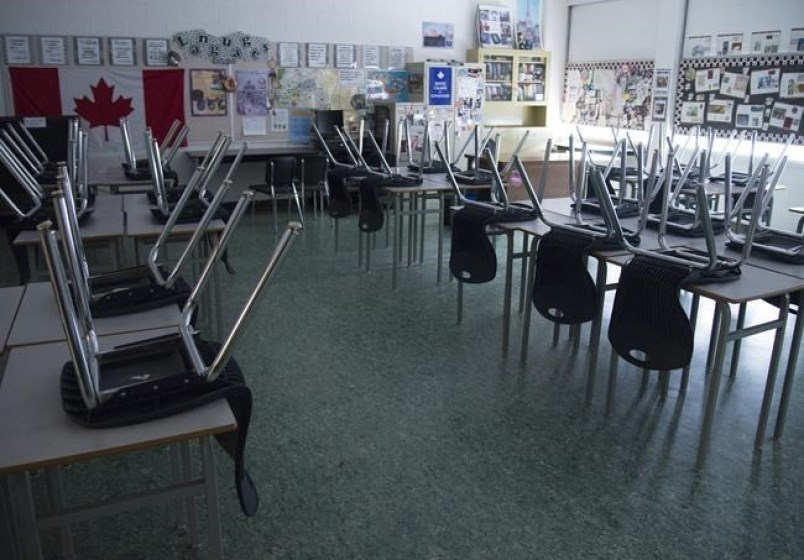 A empty classroom is pictured at Eric Hamber Secondary school in Vancouver, B.C. Monday, March 23,