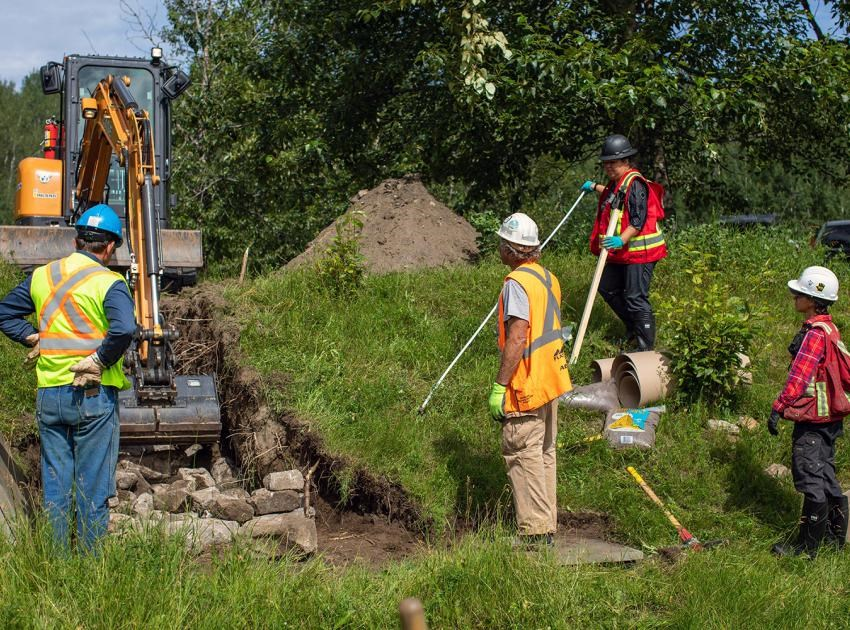 BC Hydro and Blueberry River First Nation working to build hibernacula, artificial snake dens made with rocks and soil to reduce the effects of Site C on garter snakes, July 2020.