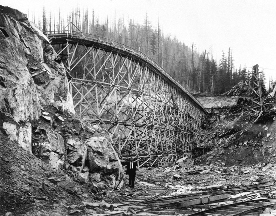 Partially constructed trestle and flume across spillway cut of Coquitlam Dam. Thought to be from May