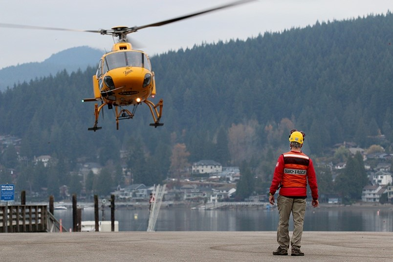 Garry Mancell, of Coquitlam Search and Rescue, sets up a safety permitter around the parking lot at Port Moody's Rocky Point Park to prepare for the arrival of a Talon helicopter during an emergency preparedness exercise in November 2019. In recent years, Coquitlam Search and Rescue has pushed its training further into Pinecone Burke Provincial Park to be prepared for what they expect to be a wave of visitors in coming years.