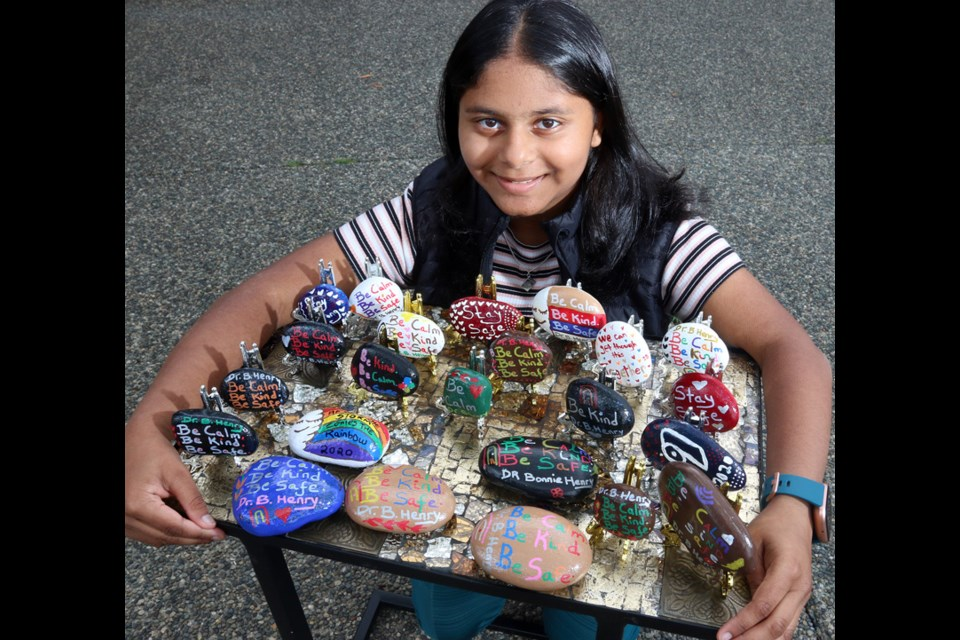 Insiyah Dharsee, 13, has embraced painting rocks with the signature message of British Columbia's medical officer, Dr. Bonnie Henry, as her way of getting through the COVID-19 pandemic.