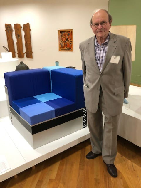 H.C. Behm with 'the Vancouver Chair' on display at the Vancouver Art Gallery.