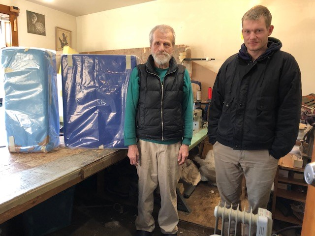 BowenIslandUpholstery's Dave and Christian with the cushions of Behm's art piece.