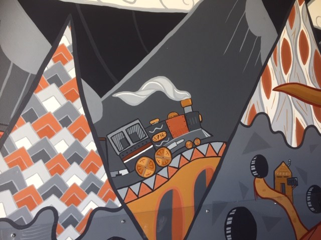 The first train through Port Coquitlam is captured in a mural by Taylor Klassen.