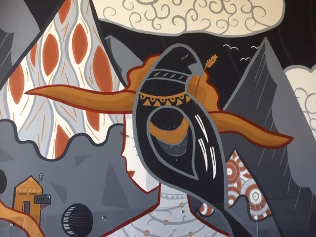 A lady and a crow in a Port Coquitlam mural
