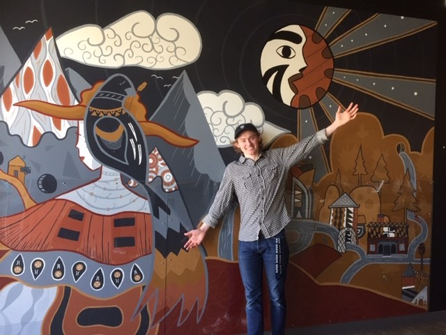 Taylor Klassen shows off the mural he recently completed at Patina Brewing Co. in Port Coquitlam.