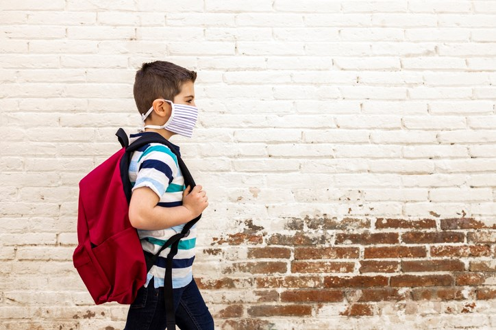 A child heads to school during the COVID-19 pandemic