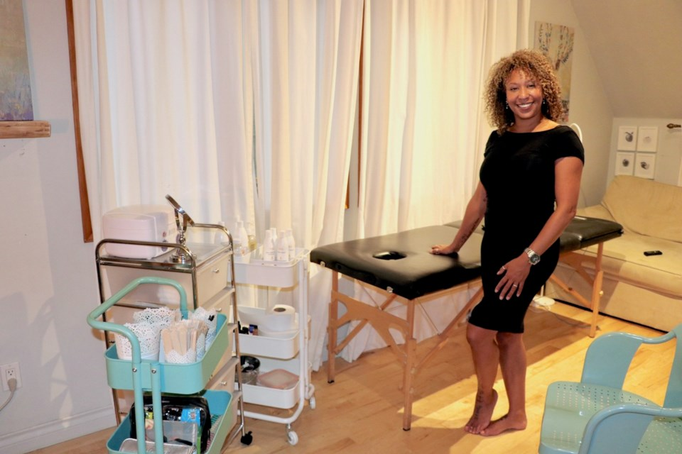 Alex McNeill standing with a waxing table