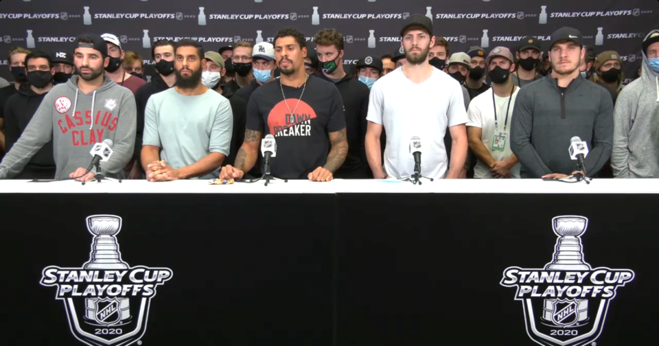 Nazem Kadri, Pierre-Edouard Bellemare, Ryan Reaves, Jason Dickinson, and Bo Horvat stand with other