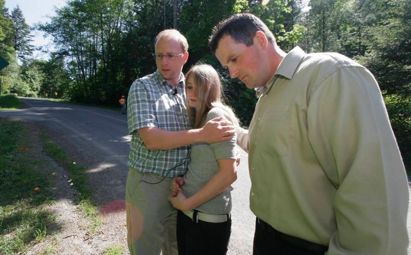 May 17, 2006: Ray Wightman, left, and Glen O'Keefe with Adriana Kelly in the area on Triangle Mountain where they and friend Chris Johnson found an infant Kelly abandoned in a ditch. DEBRA BRASH, TIMES COLONIST