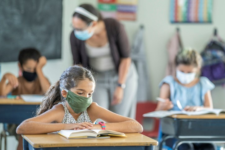 12-year-old in an elementary classroom