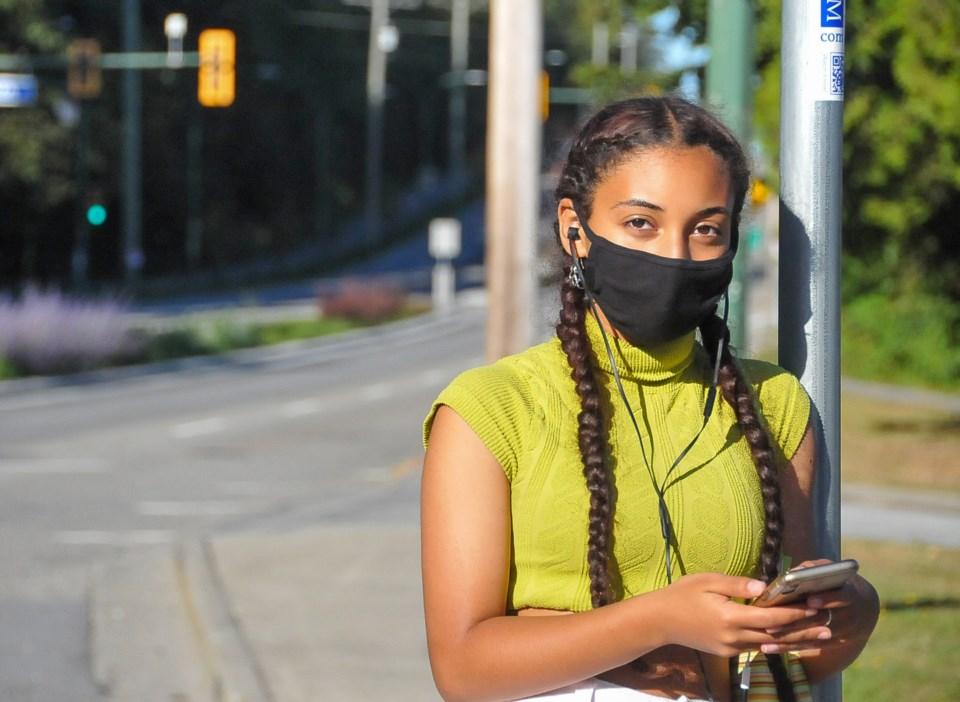 Coquitlam Grade 10 student Tasio Cielo, 15, waits for a bus outside Dr. Charles Best secondary after
