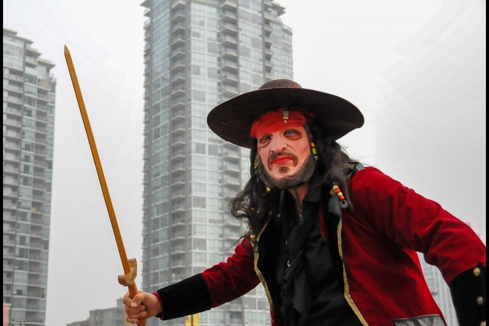 A pirate volunteer atop Coquitlam Centre in an event repurposed for 'landlubbers' after the COVID-19 pandemic made it impossible to socially distance aboard a ship.