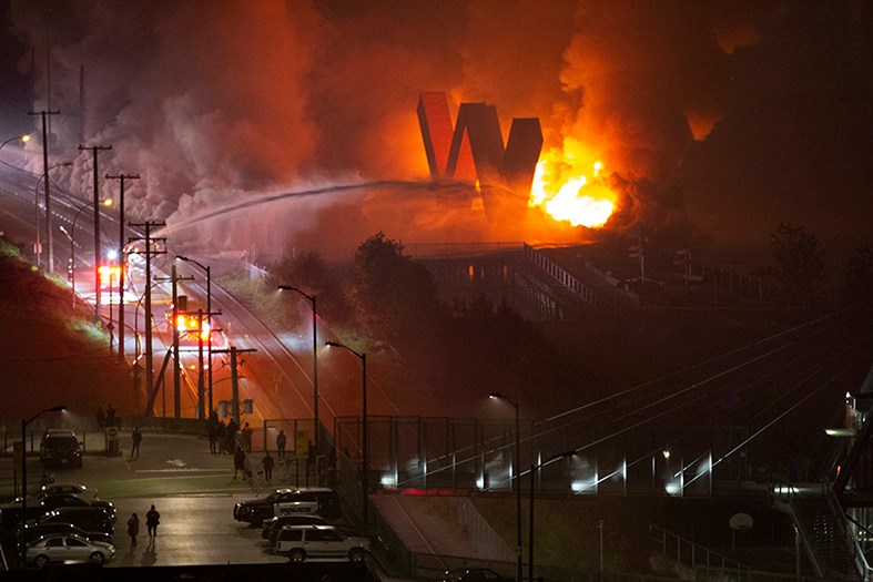 New Westminster's famous 'W' threatened by flames at Westminster Pier Park. Rick Fabbro photo