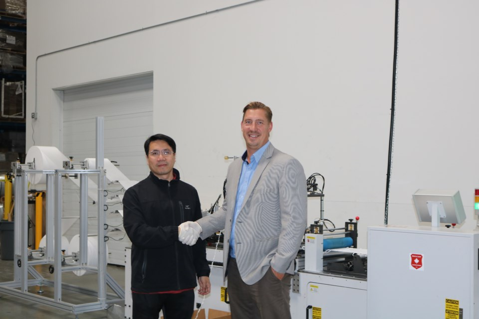 Guoren Zhang(left), instructor at Kwantlen Polytechnic University's School of Business, and Mark Rose, CEO of Layfield Group. Photo submitted