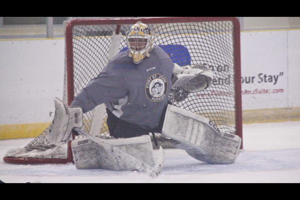 Tyler McArthur stretches to make a save during Huskies training camp on September 13, 2020. McArthur is back for his second season as Huskies goalie.