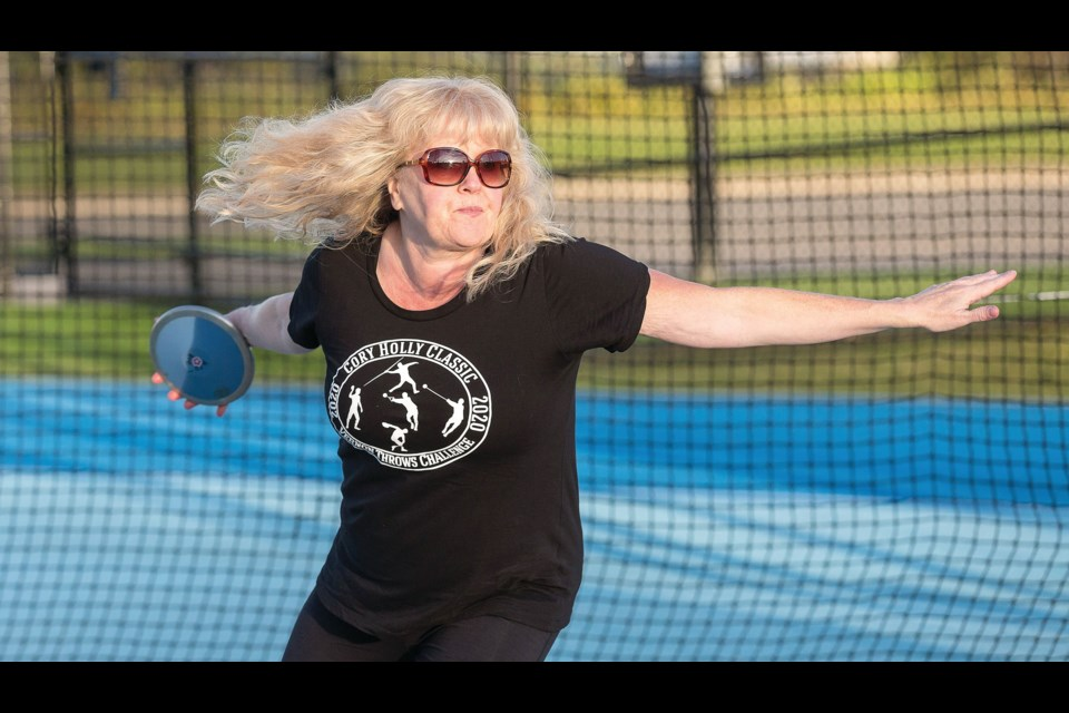 Christine Hinzmann, Citizen reporter, is seen here throwing the discus. During the Sept. 19 Cory Holly Throws Challenge held in Vernon Hinzmann broke the BC record for the weight throw and squeaked by the BC record for the Throws Pentathlon that's held strong since 2007 by Canadian record-holder Rose Hare.
