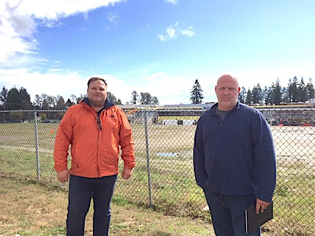 Centennial parents, including Tony Oljaca and Giulio Caravatta, are upset that it's taken so long to build a neighbourhood learning centre and artificial turf field, both of which should have been built by now.