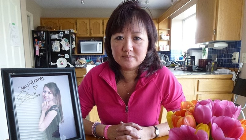 Carol Todd, a Port Coquitlam teacher, with a photo of her daughter, Amanda,