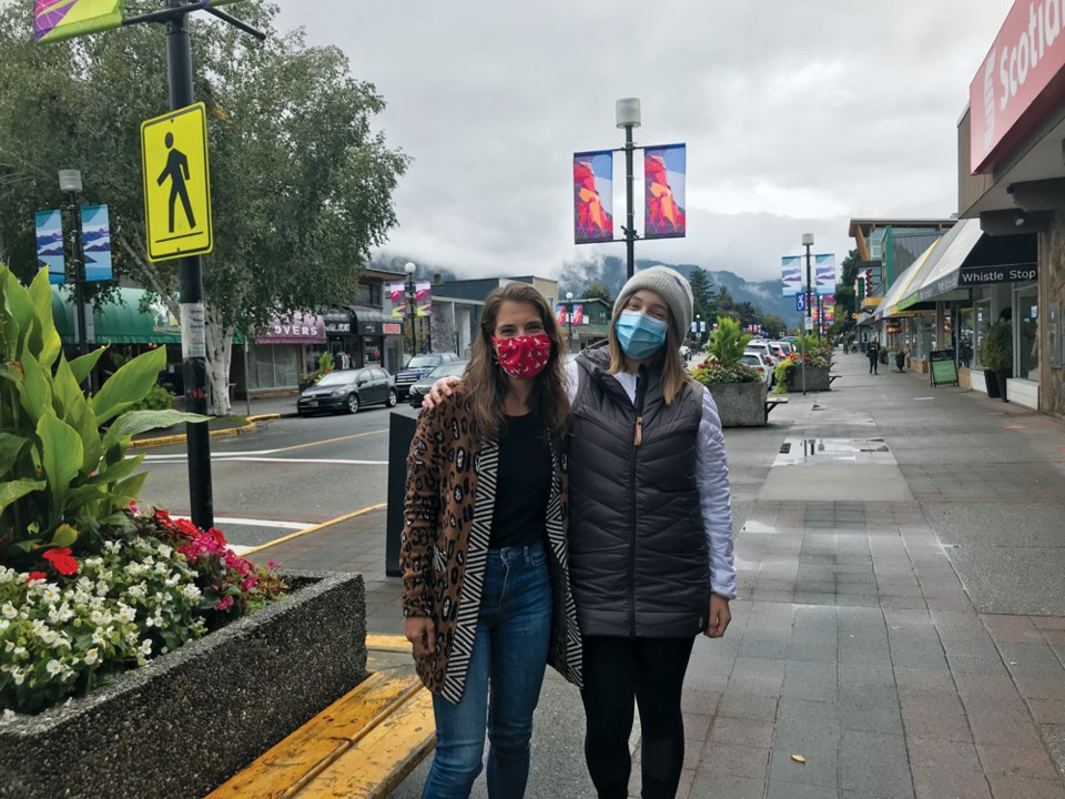 Jenna Becker and Sarah Beech in downtown Squamish last week.