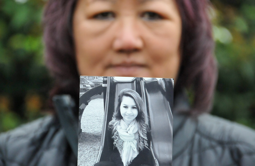 Carol Todd, with a photo of her daughter Amanda