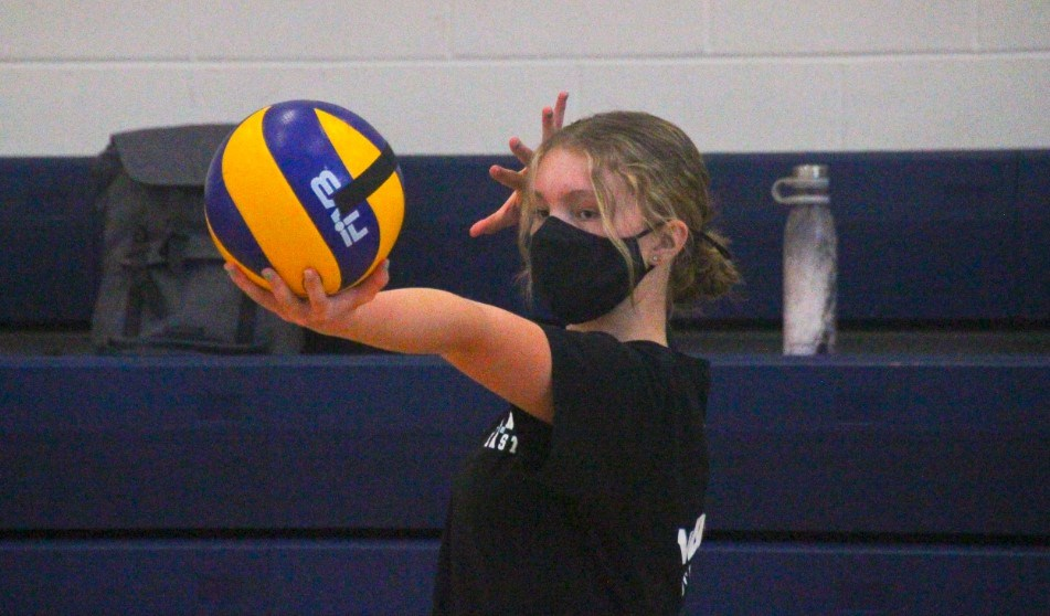 Kallie Mickey is focused in on hitting a sharp server during an NPSS Junior Girls Volleyball practice on October 1, 2020. All volleyball players are required to wear a mask while they are engaged in volleyball activities.