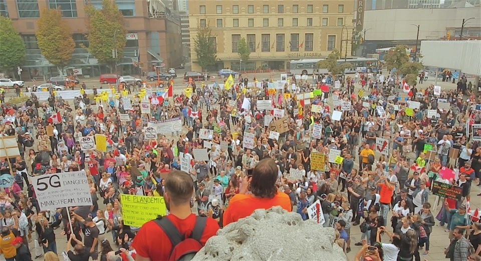 Several hundred anti-maskers marched the streets and gathered at Vancouver Art Gallery in September.