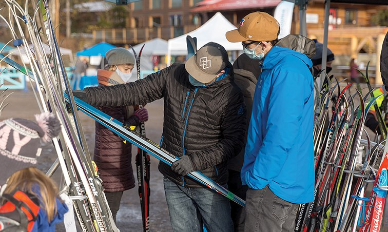 Citizen Photo by James Doyle. A volunteer helps a shopper examine a pair of skis that are for sale on Saturday morning at the Caledonia Nordic Ski Swap and Outdoor Market at the Otway Nordic Centre. Roughly 250 people were lined up when the ski swap opened at 9 a.m.