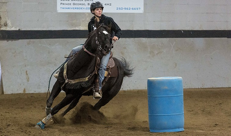 Citizen Photo by James Doyle. A horse and rider race around barrels on Saturday morning at the Prince George Agriplex while competing in a Gymkhana that was hosted by the Prince George Rodeo Association.
