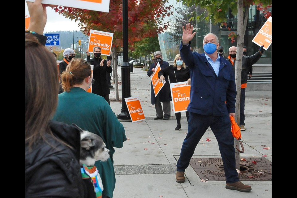 BC NDP Leader John Horgan at a sign waving event near the Lincoln SkyTrain station in Coquitlam Tuesday, Oct. 20. As the campaign enters its last week, Horgan is looking to get out the party's end game messaging to key ridings like Coquitlam-Burke Mountain.