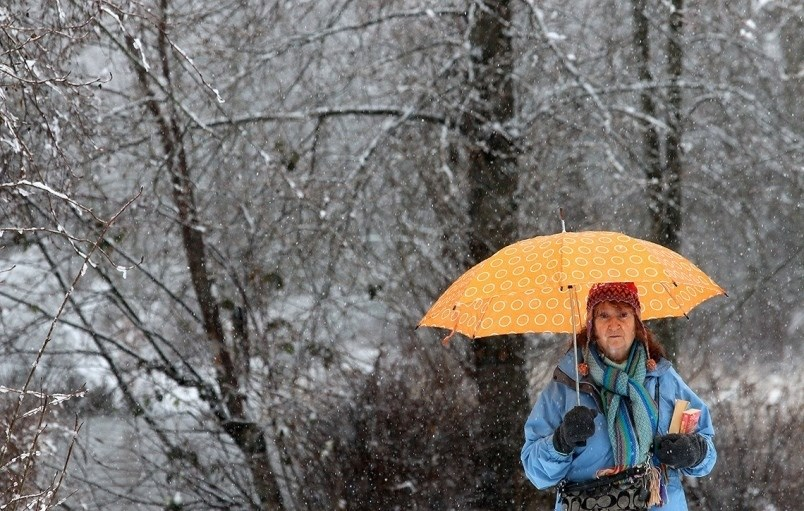 A woman walks through the snow in Coquitlam