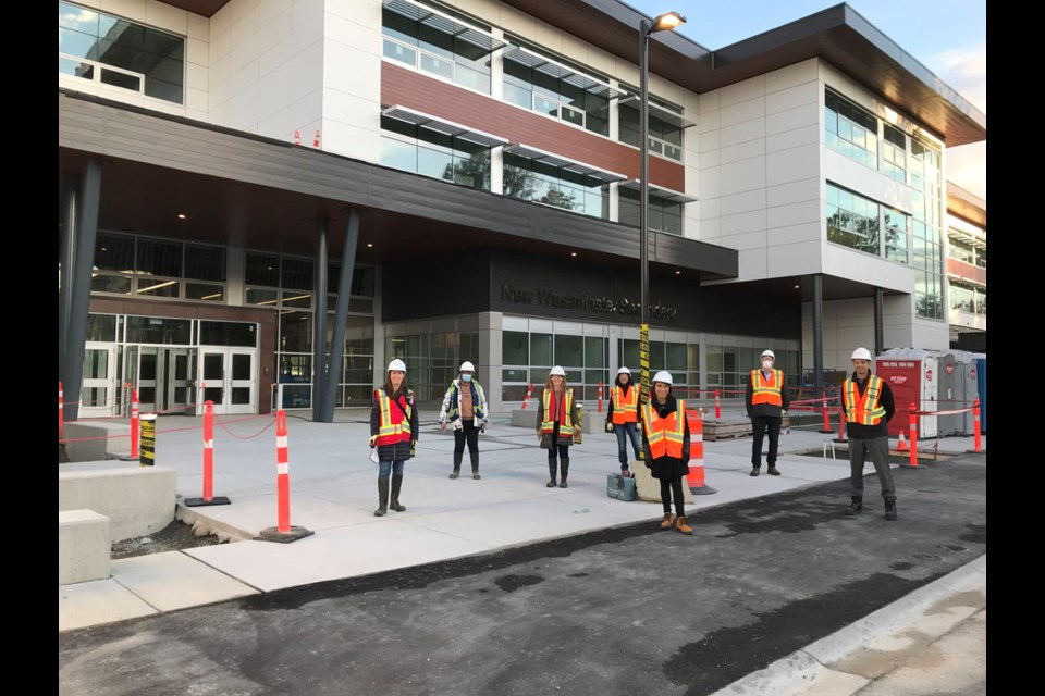 Trustees and senior staff pose outside the new building.