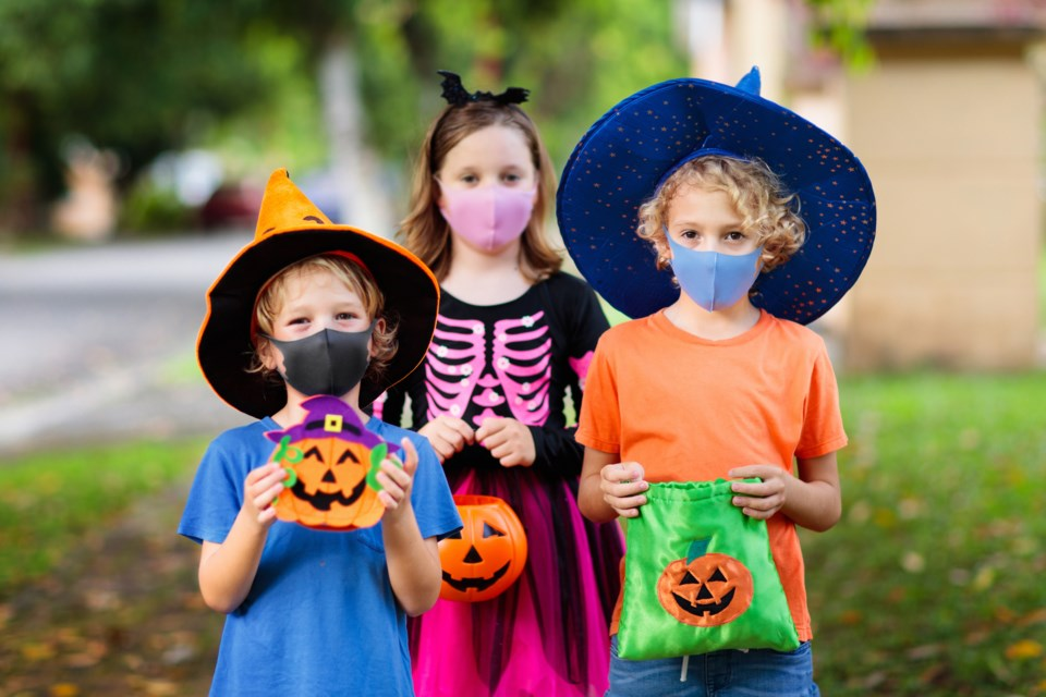 trick-or-treating, kids in masks, Halloween