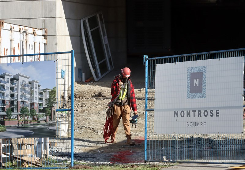 Construction worker outside the Montrose Square condo development in Port Coquitlam. At least six people have tested positive for COVID-19 at the site.