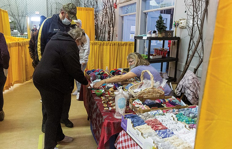 Citizen Photo by James Doyle/Local Journalism Initiative. Shoppers check out a vendors booth on Saturday morning at the Hart Community Centre's Winter Market.